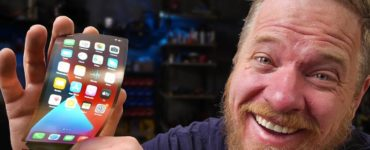 1614910001 A YouTuber connects a flexible screen to his iPhone and