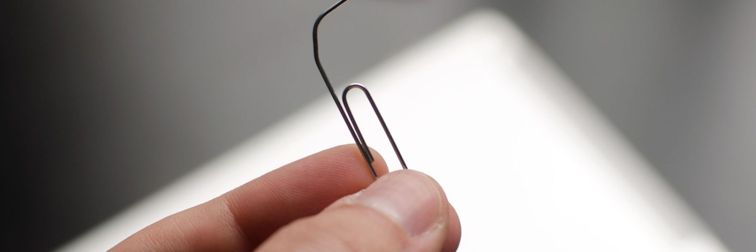 Can I use a paperclip to remove SIM card?