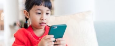 How can I monitor my child's phone without them knowing?