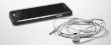 How can I play music on my iPhone 11 without the headphone jack?