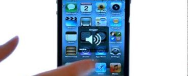 How do I change the volume on my iPhone?