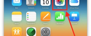 How do I download my iCloud photos to my iPhone?