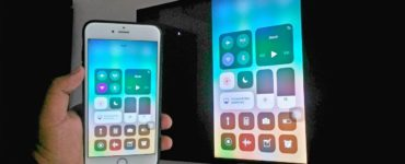 How do I enable screen mirroring on my iPhone?